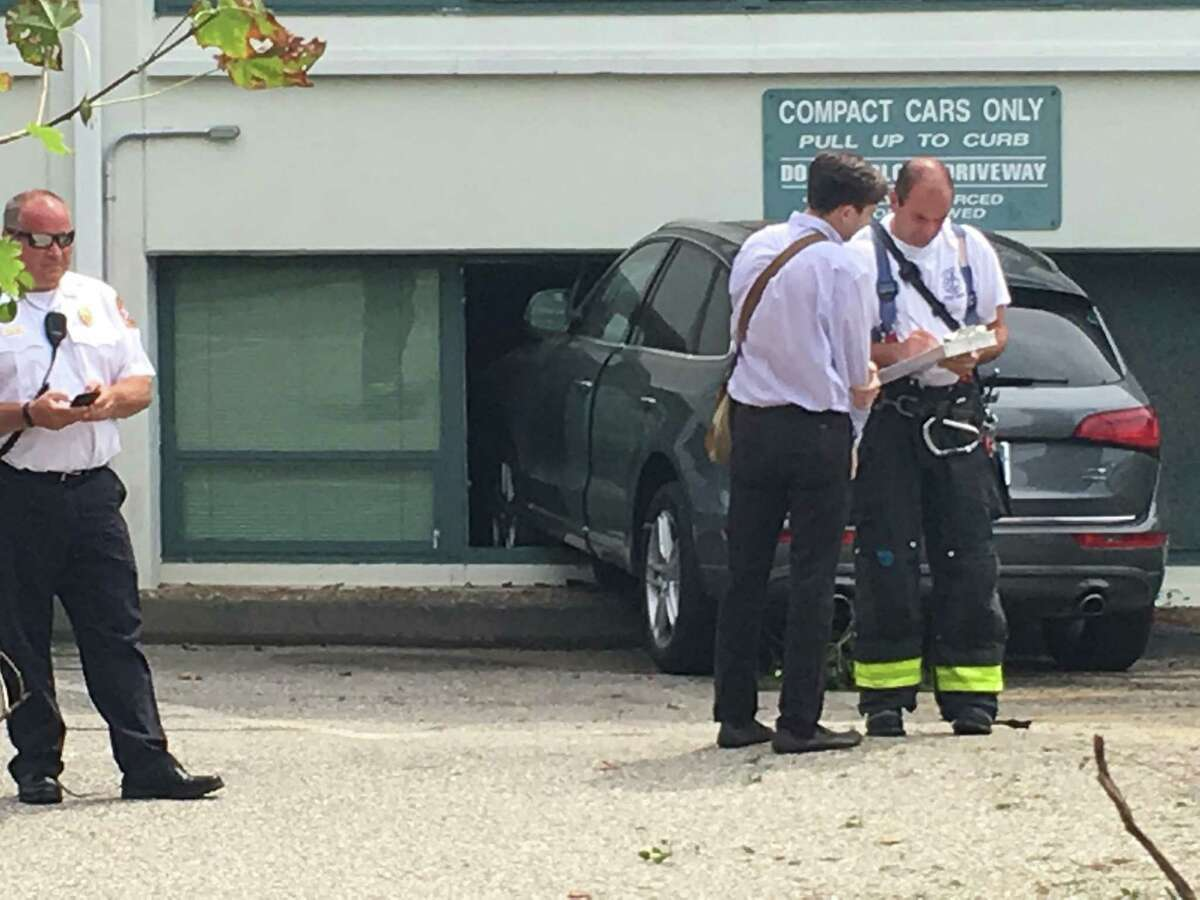 A car struck a building at 83 East Ave. on Monday afternoon.. The accident that also involved another vehicle in the parking brought first responders to the scene around 1 p.m.