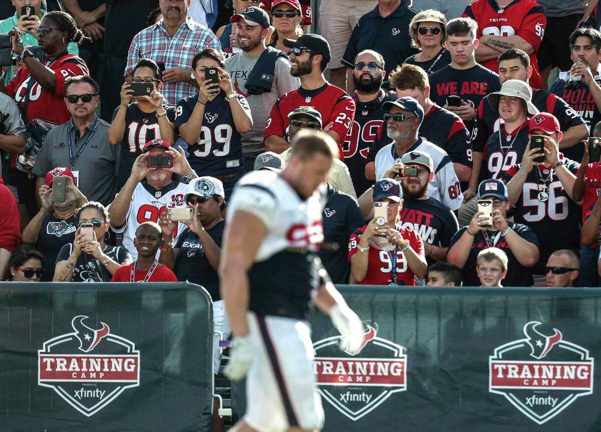 Houston Texans fans watch practice as defensive end J.J. Watt walks past during training camp at The Methodist Training Center on Tuesday, Aug. 22, 2017, in Houston.