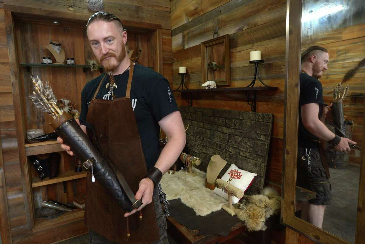 Colin Maythenyi, leather artisan and owner of Knotted Bone, a new business specializing in chain mail jewelry and medieval leather goods, at his shop Friday, August 18, 2017, on Washington Street in Norwalk, Conn.