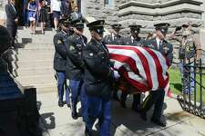"""Family of Patrick J. Byrnes, known as """"Bud,"""" who was killed in action in 1943 at the age of 23, follow his remains being carried by an Honor Guard from the Connecticut Army National Guard. Byrnes was given a  Military honors burial and funeral mass on Saturday, August 19, 2017 in Stamford, Connecticut. His remains were recently identified by the U.S. Army and returned to his family."""
