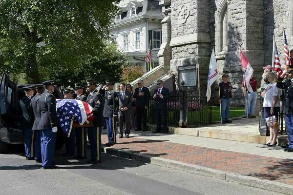 """Family of Patrick J. Byrnes, known as """"Bud,"""" who was killed in action in 1943 at the age of 23, follow his remains being carried by an Honor Guard from the Connecticut Army National Guard into Basilica of St. John the Evangelist church. Byrnes was given a  Military honors burial and funeral mass on Saturday, August 19, 2017 in Stamford, Connecticut. His remains were recently identified by the U.S. Army and returned to his family."""