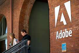 People exit the Adobe Systems Inc. office in San Francisco, California, U.S., on Tuesday, June 21, 2011. Adobe Systems Inc., the largest maker of graphic-design software, reported second-quarter sales that exceeded analysts' estimates, rebounding from a disruption in demand caused by the March earthquake in Japan. Photographer: David Paul Morris/Bloomberg