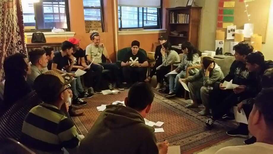 Youth Coordinator Christopher Espino (middle of the photo) leads a Restorative Justice circle at YES Prep Northbrook High School. Photo: YES Prep Northbrook High School
