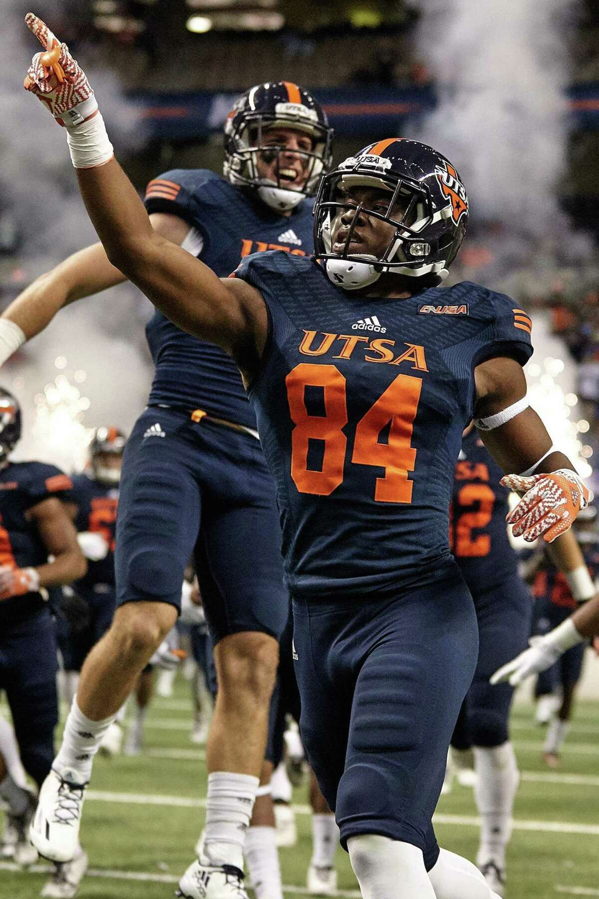 UTSA receiver Larry Stephens celebrates as the Roadrunners take the field at the Alamodome to face Charlotte on Nov. 26, 2016, at the Alamodome.
