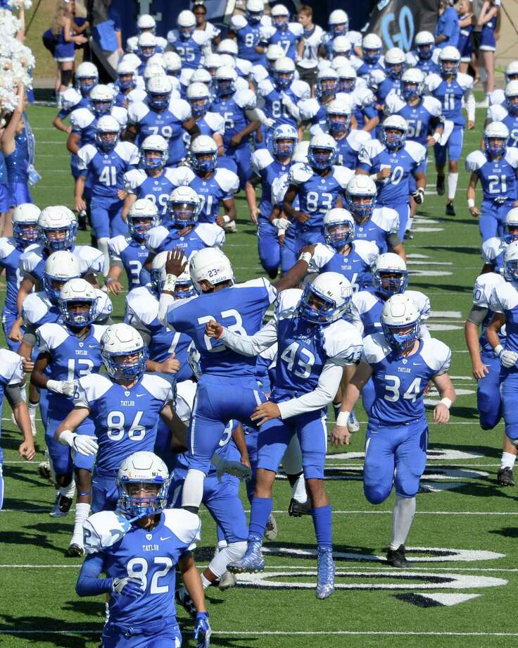 Taylor High School will host Foster High School for the historic opening football game at Legacy Stadium. The game will start at 6:30 p.m. Aug  31.  Above, Taylor Mustangs take the field at Rhodes Stadium during a 6A Region III Bi-District playoff game against the Kempner Cougars on Nov. 12, 2016. Photo: Craig Moseley, Staff / ©2016 Houston Chronicle