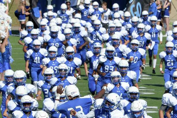 Taylor High School will host Foster High School for the historic opening football game at Legacy Stadium. The game will start at 6:30 p.m. Aug  31.  Above, Taylor Mustangs take the field at Rhodes Stadium during a 6A Region III Bi-District playoff game against the Kempner Cougars on Nov. 12, 2016.