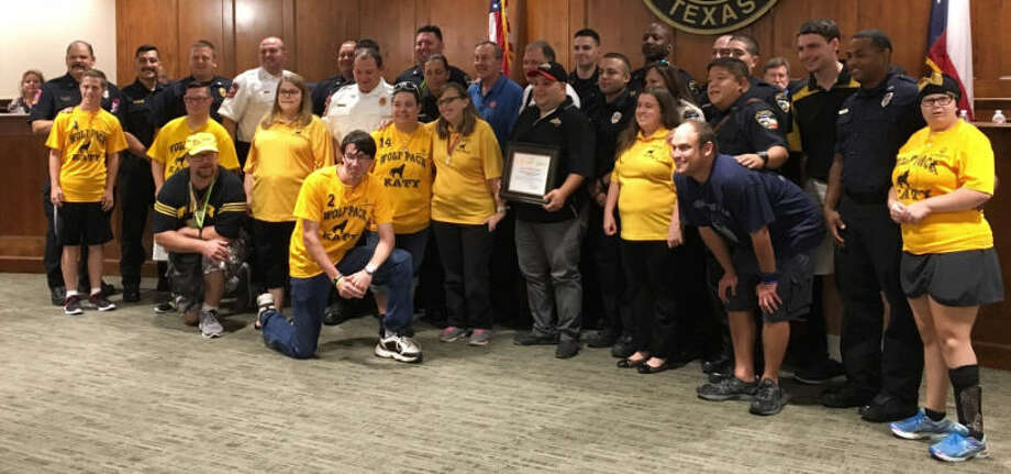 "Los Cucos Mexican Cafe of Katy received recognition Aug. 14 at the Katy City Council meeting for hosting of the 2017 Katy ""Tip A Firefighter"" fundraiser benefiting Special Olympics Texas. Taking part in the recognition are members of the Katy Fire Department and the Katy Wolf Pack, one of the largest Special Olympics teams in the Greater Houston area. Photo: Karen Zurawski"
