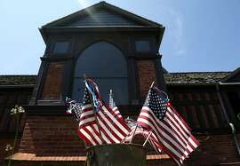 American flags decorate the lawn in front of the Church of the Presidents in Long Branch, N.J., Thursday, Aug. 10, 2017. The church was named for the seven U.S. presidents that worshipped there, often while on vacation in New Jersey.  President Donald Trump is spending nearly three weeks in New Jersey at his golf club, but he's far from the first U.S. president to summer in the Garden State. (AP Photo/Seth Wenig)