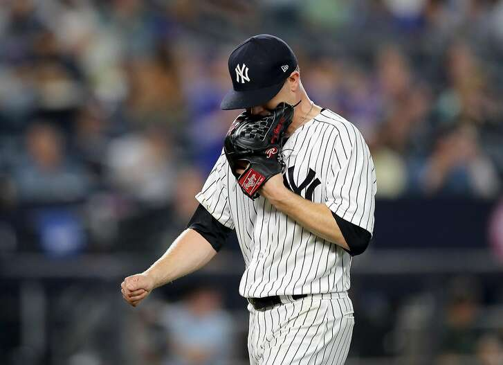 NEW YORK, NY - AUGUST 15:  Sonny Gray #55 of the New York Yankees reacts as he is pulled from the game in the seventh inning against the New York Mets during interleague play on August 15, 2017 at Yankee Stadium in the Bronx borough of New York City.  (Photo by Elsa/Getty Images)