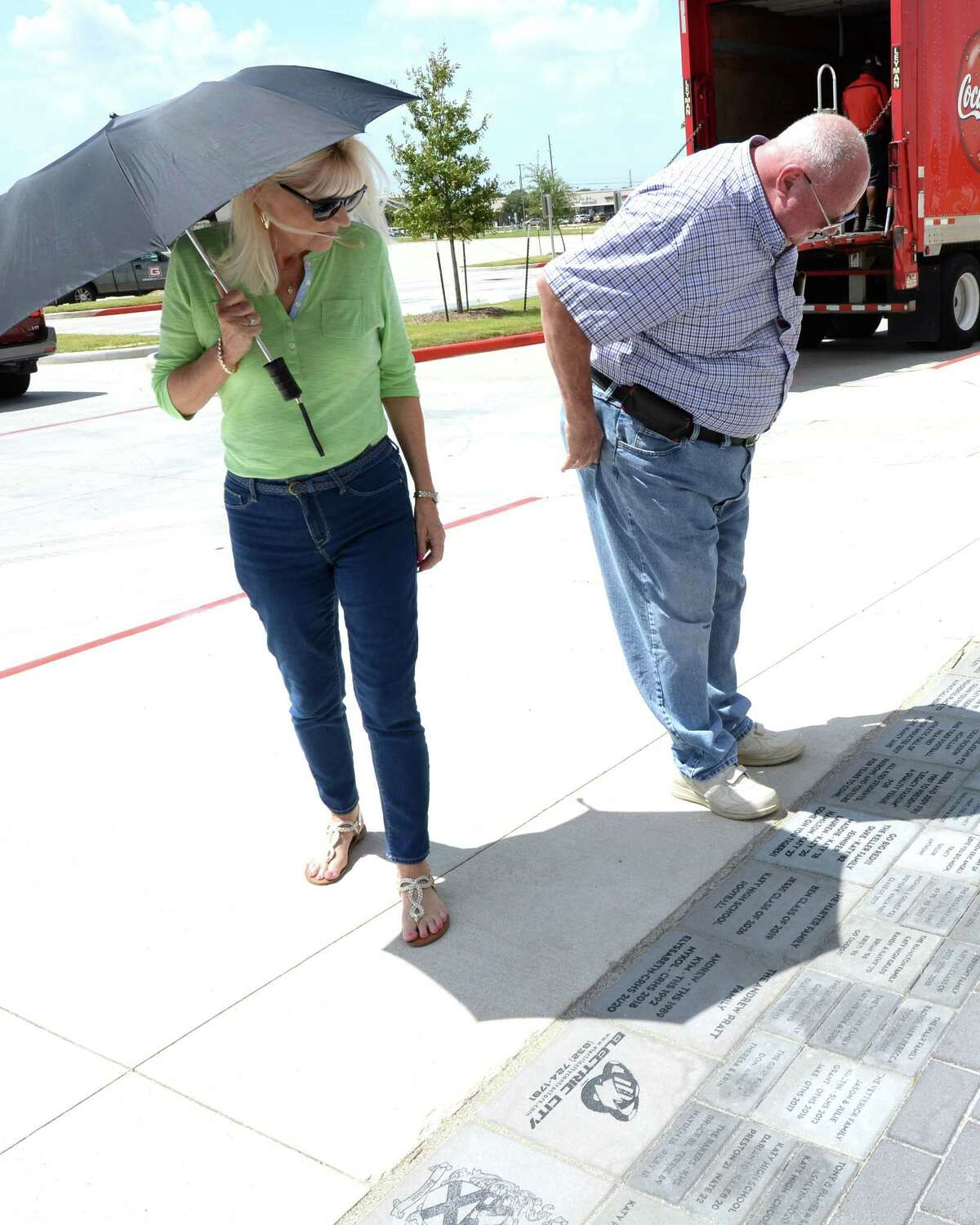 Visitors view brick pavers located on the home side of the Katy ISD Legacy Stadium in Katy, TX on August 17, 2017. Proceeds from the sale of the brick pavers will go toward the Katy ISD Athletic Hall of Honor.