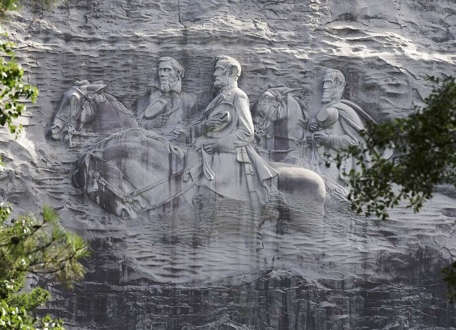 FILE - This June 23, 2015 file photo shows the carving depicting Confederate Civil war figures Stonewall Jackson, Robert E. Lee and Jefferson Davis, in Stone Mountain, Ga.  Photo: John Bazemore, Associated Press