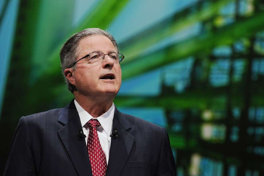 (FILES) This file photo taken on June 2, 2015 shows Chevron Chairman and CEO John Watson as he addresses a keynote speech during the World Gas Conference in Paris. Chevron chief executive John Watson plans to step down as the petroleum industry prepares for a period of lower oil prices, the Wall Street Journal reported on August 22, 2017. A transition would be announced next month. The leading front-runner to replace Watson is executive vice president Mike Wirth, but the plan has not been finalized and could still change, said the newspaper, citing unnamed sources. / AFP PHOTO / ERIC PIERMONTERIC PIERMONT/AFP/Getty Images Photo: ERIC PIERMONT, AFP/Getty Images