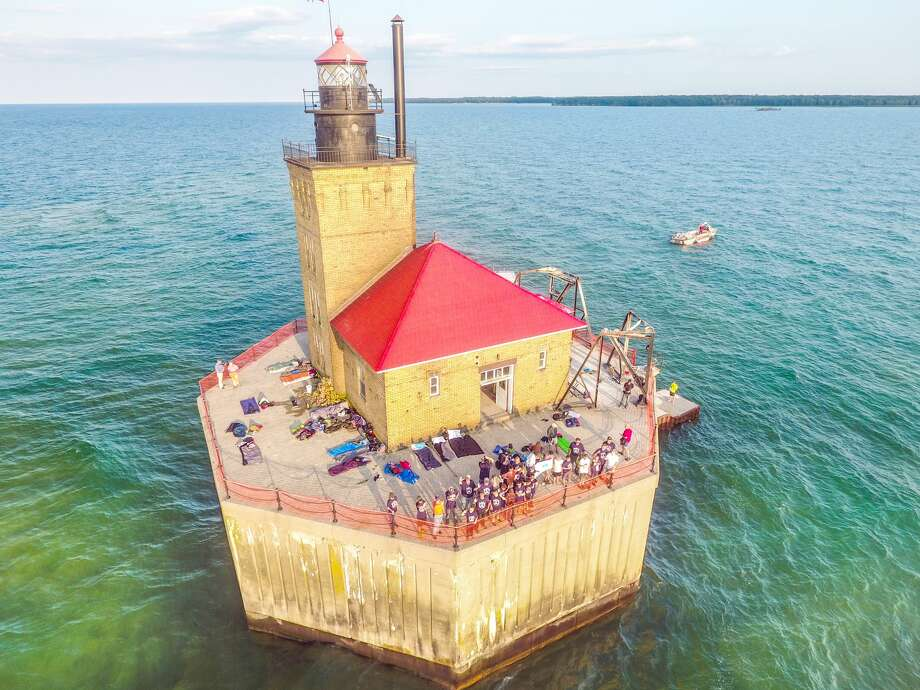 Nearly 60 area boy scouts, as well as chaperones, recently spent the night on the Port Austin Reef Lighthouse. The Port Austin Lighthouse Association made multiple trips to get the scouts out to the lighthouse safely by boat, pontoon and the lark. Photo: Tyler Leipprandt, Michigan Sky Media/For The Tribune