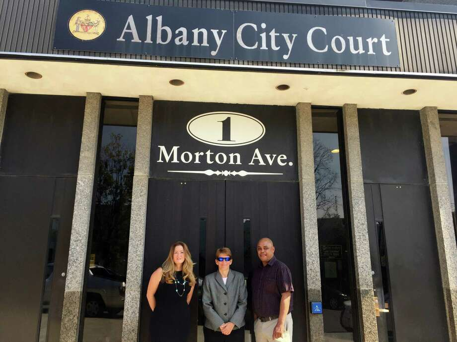 City Court Judge Holly Trexler, left, who launched a program for a homeless advocate in City Court, stands outside courthouse at 1 Morton Ave.  on Monday besides Liz Hitt, executive director of the Homeless and Travelers Aid Society and Tyrone Coleman, a navigator for HATAS who will serve as the homeless advocate in the courthouse on Mondays and Thursdays.  The judge and HATAS collaborated to bring about the new program, which will work to find homeless defendants a place to live, assess their situation and work with county public defenders and prosecutors to prevent a revolving of homeless defendants repeatedly returning to court for low-level offenses. (Robert Gavin/Times Union) Photo: Will Waldron, Albany Times Union