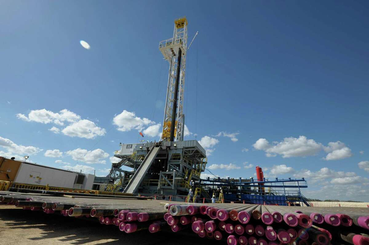 One of BHP Billiton Petroleum's Eagle Ford drilling rigs is shown in this file photo, with production casing in the foreground.