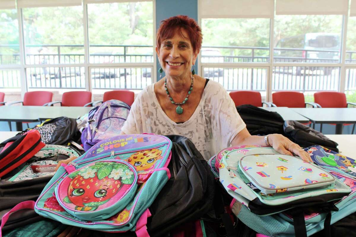 Lauren Hughes of Wilton Youth Services with the 75 backpacks available for students in need.
