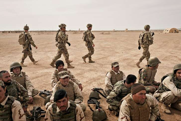 FILE -- U.S. Army soldiers oversee the training of Afghan National Army soldiers in Helmand Province, Afghanistan, March 22, 2016. After nearly 16 years of war, America�s longest, the Taliban in Afghanistan are not only far from defeated, they are gaining ground and have evolved into a more tenacious foe than the one routed in 2001, making a United States military triumph seem more remote. (Adam Ferguson/The New York Times)