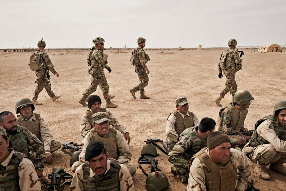 FILE -- U.S. Army soldiers oversee the training of Afghan National Army soldiers in Helmand Province, Afghanistan, March 22, 2016. After nearly 16 years of war, America's longest, the Taliban in Afghanistan are not only far from defeated, they are gaining ground and have evolved into a more tenacious foe than the one routed in 2001, making a United States military triumph seem more remote. (Adam Ferguson/The New York Times) Photo: ADAM FERGUSON, NYT