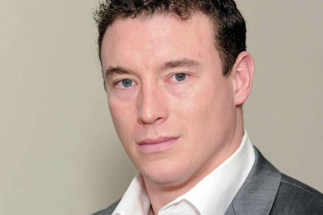 Carl Higbie, a former Navy SEAL who did two tours of duty in Iraq, has become the Trump administration's external affairs chief for community service.