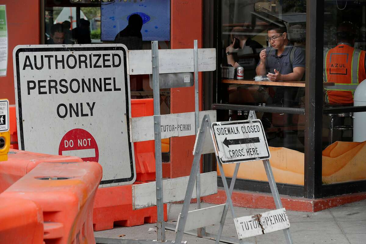 Student Chris Shimizu gets a bite to eat at Oasis Grill on the corner of Howard and 4th street where business has plunged with all the subway construction just outside their doors, in San Francisco, Ca., as seen on Thurs. August 10, 2017.