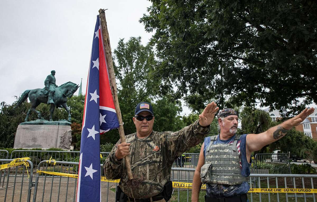 Protesters salute in Emancipation Park prior to the Unite the Right rally in Charlottesville,Va., on Saturday. MUST CREDIT: Photo for The Washington Post by Evelyn Hockstein