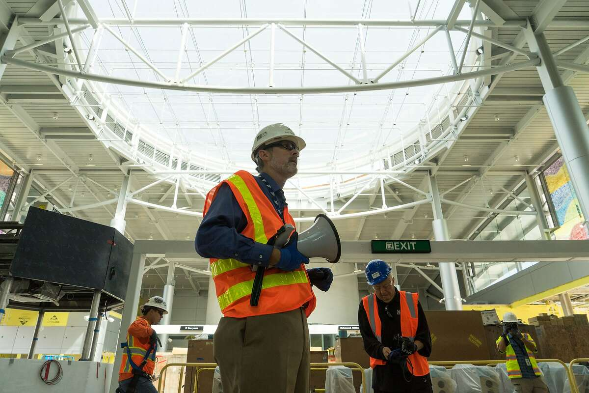 John Engstrom, project manager of the Silicon Valley Bart Extension, gives the media a tour of the future Milpitas Bart Station in Milpitas, Calif. on Tuesday, Aug. 22, 2017.