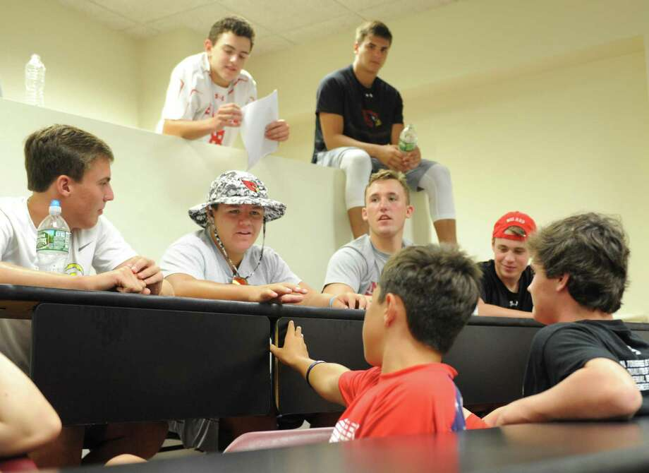 GHS junior Joe Kraninger, center, discusses a video shown by the anti-domestic violence nonprofit One Love with fellow football players during a presentation at Greenwich High School in Greenwich, Conn. Tuesday, Aug. 22, 2017. One Love discussed how to recognize and prevent domestic violence while showing videos and holding small group workshops. Photo: Tyler Sizemore / Hearst Connecticut Media / Greenwich Time