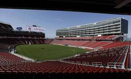 A groundskeeper drives across the field before the ribbon-cutting and opening of Levi's Stadium Thursday, July 17, 2014, in Santa Clara, Calif. The San Francisco 49ers held a ribbon-cutting ceremony to officially open their new home. The $1.2 billion Levi's Stadium, which took only about 27 months to build, also will host the NFL Super Bowl in 2016 and other major events. (AP Photo/Eric Risberg)