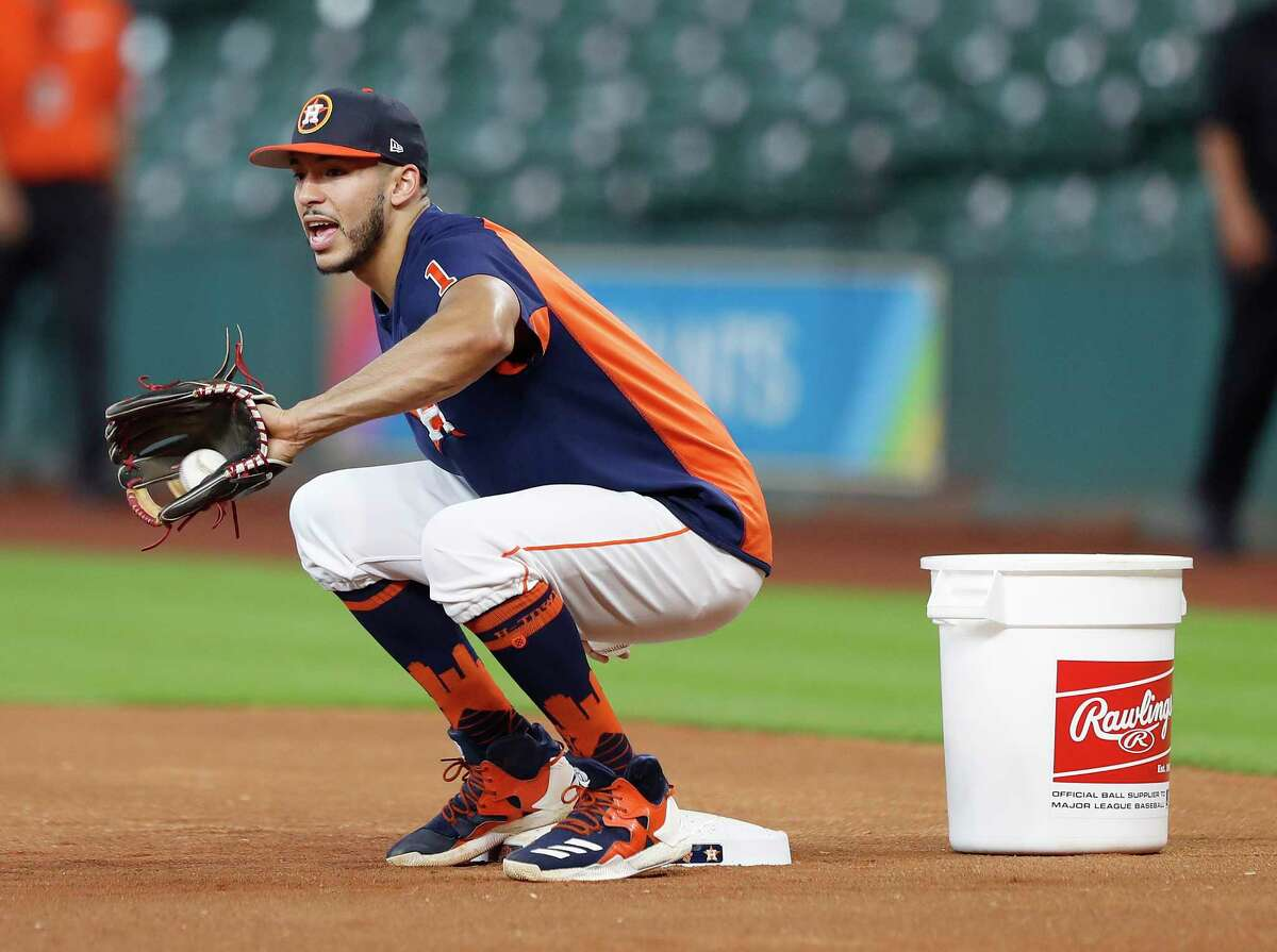 PHOTOS: Carlos Correa taking infield practice before Tuesday's game Carlos Correa works out at first base with the team during batting practice before the start of an MLB game at Minute Maid Park, Tuesday, Aug. 22, 2017, in Houston.