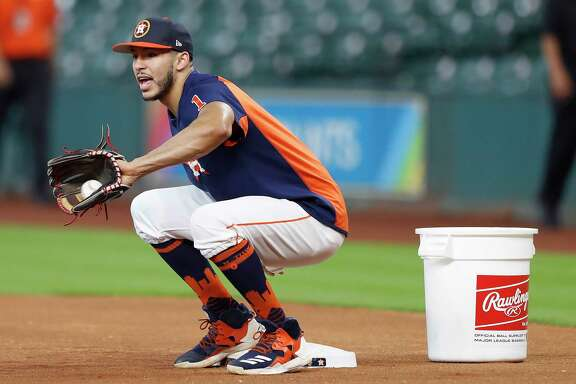 Carlos Correa works out at first base with the team during batting practice before the start of an MLB game at Minute Maid Park, Tuesday, Aug. 22, 2017, in Houston.