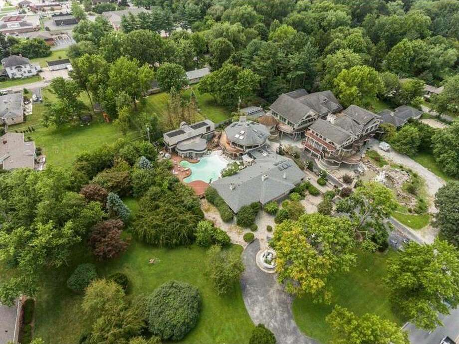 """Described as """"famously heinous """" and """"notably ghastly,"""" the eye-popping Kessler mansion in Indianapolis is back on the market, priced at $1,750,000. The 29,500-square-foot compound comes with 11 bedrooms, eight bathrooms, and one extremely strange history. Photo: Realtor.com"""