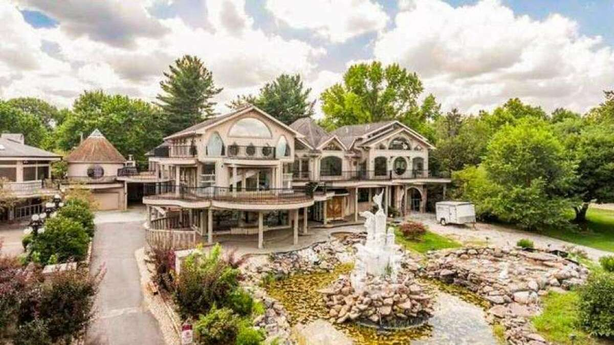 """Described as """"famously heinous """" and """"notably ghastly,"""" the eye-popping Kessler mansion in Indianapolis is back on the market, priced at $1,750,000. The 29,500-square-foot compound comes with 11 bedrooms, eight bathrooms, and one extremely strange history."""