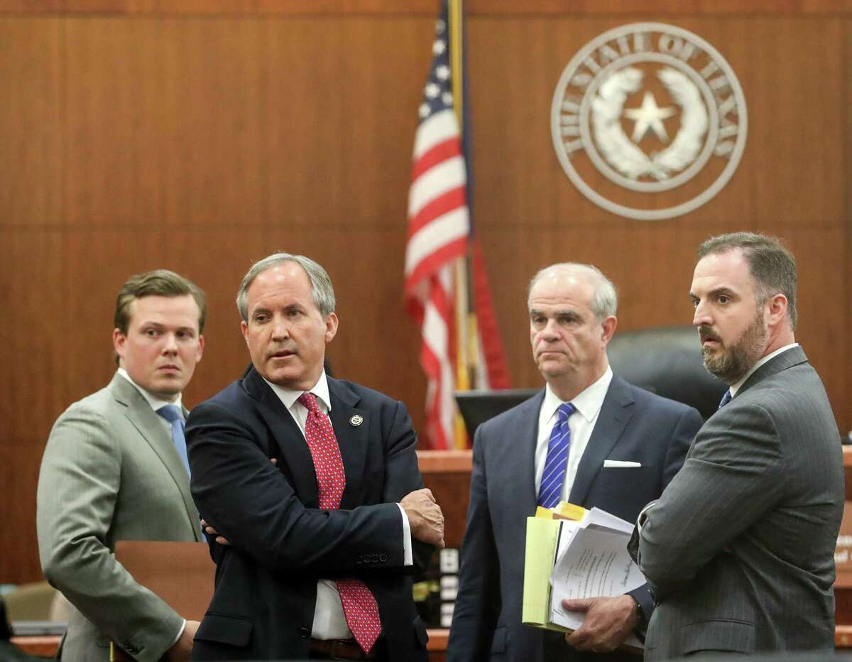 Texas Attorney General Ken Paxton, second from left, waits with members of his legal team, Cordt Akers, left, Philip Hilder, second from right, and Mitch Little, right, in the 177th District Court, at the Harris County Criminal Justice Center, Thursday, June 29, 2017, in Houston. Paxton is facing two counts of felony securities fraud, and a lesser felony charge of failing to register as an insurance adviser with the state. ( Jon Shapley / Houston Chronicle )