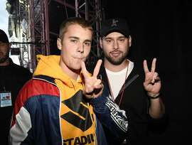 Justin Bieber (L) and Scooter Braun backstage during the One Love Manchester Benefit Concert at Old Trafford Cricket Ground on June 4, 2017 in Manchester, England.