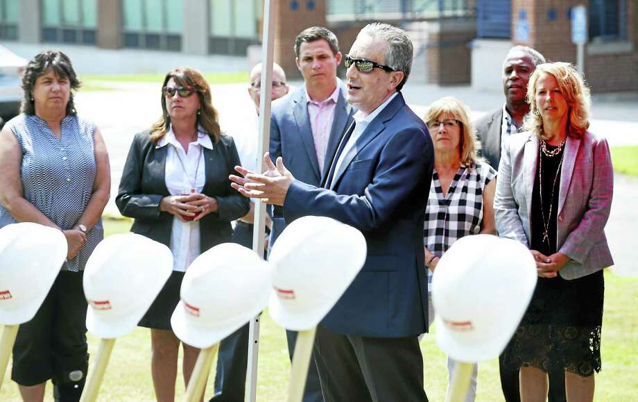 West Haven Superintendent of Schools Neil Cavallaro speaks at the ground-breaking ceremony for the new West Haven High School near the entrance to the old school on Tuesday. Photo: Arnold Gold / Hearst Connecticut Media / New Haven Register