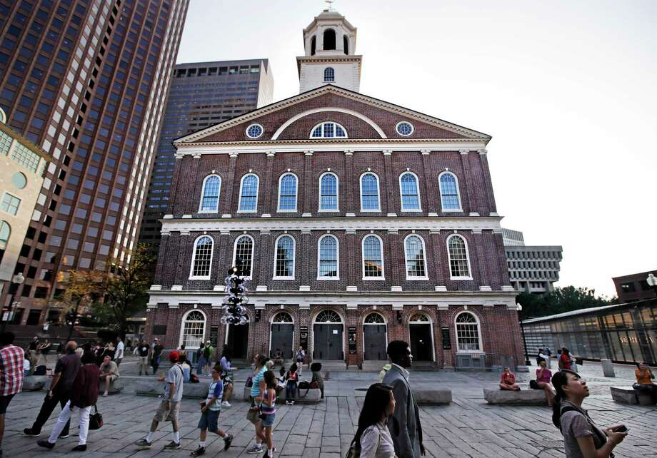 """Pedestrians pass Faneuil Hall, also known as """"the Cradle of Liberty"""" in Boston, Monday, Aug. 21, 2017. As U.S. cities grapple with what to do with Confederate monuments, a movement is afoot to rename the historic hall, where the earliest calls for independence from Britain were sounded in the late 1700s. It was named for Peter Faneuil, a merchant who owned and traded slaves. (AP Photo/Charles Krupa) Photo: Charles Krupa, STF / Copyright 2017 The Associated Press. All rights reserved."""