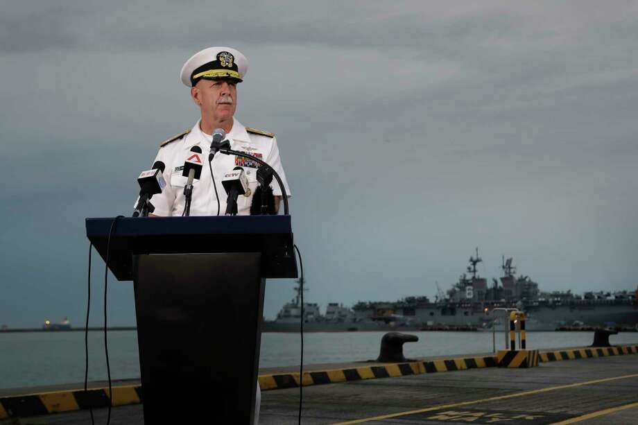 Commander of the U.S. Pacific Fleet, Scott Swift answers questions during a press conference with the USS John S. McCain and USS America docked in the background at Singapore's Changi naval base on Tuesday, Aug. 22, 2017, in Singapore. The focus of the search for 10 U.S. sailors missing after a collision between the USS John S. McCain and an oil tanker in Southeast Asian waters shifted Tuesday to the damaged destroyer's flooded compartments. (AP Photo/Wong Maye-E) Photo: Wong Maye-E, STF / Copyright 2017 The Associated Press. All rights reserved.