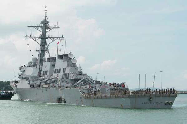 In this Aug. 21, 2017, photo provided by U.S. Navy, the guided-missile destroyer USS John S. McCain (DDG 56) steers towards Changi Naval Base, Singapore, following a collision with the merchant vessel Alnic MC while underway east of the Straits of Malacca and Singapore. Navy and Marine Corps divers will enter flooded compartments on the USS John S. McCain to search for 10 sailors missing after the destroyer and an oil tanker collided in Southeast Asian waters, the 7th Fleet said Tuesday, Aug. 22, 2017. (Mass Communication Specialist 2nd Class Joshua Fulton/U.S. Navy via AP)