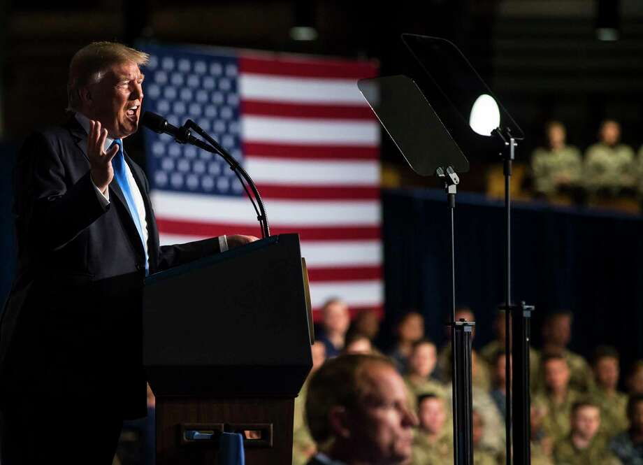 President Donald Trump delivers an address to the nation Monday at Fort Myer in Arlington, Va. (Al Drago/The New York Times) Photo: AL DRAGO, STR / NYTNS