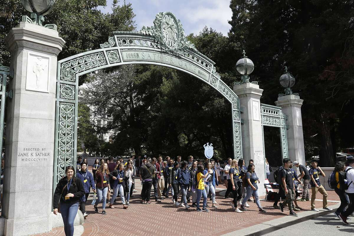 Students walk on the UC Berkeley campus Tuesday, Aug. 15, 2017, in Berkeley. UC Berkeley Chancellor Carol Christ says the university is committed to protecting free speech, and is allowing former Breibart editor Ben Shapiro to visit and speak on campus, despite concerns about violent protests.