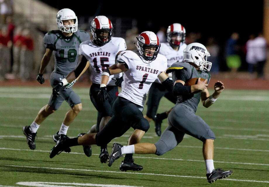 Porter linebacker Jonathan Dullen (1) chases down Kingwood Park running back Preston Miller (22) during the third quarter of a District 21-5A high school football game Thursday, Sept. 22, 2016, in Humble. Porter defeated Kingwood Park 31-0. Photo: Jason Fochtman, Staff / Houston Chronicle