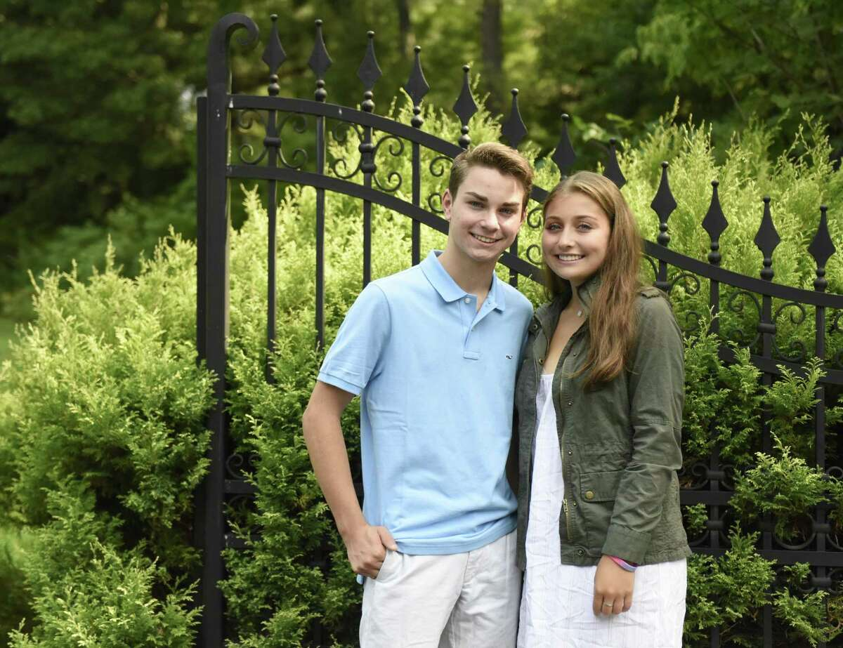 Twins Max and Kate Konigsberg, incoming freshmen at Greenwich High School, pose outside their home in Greenwich on Tuesday. The pair produced a video about the opioid epidemic for their Western Middle School capstone project in the spring. They are passionate about the issue and have organized a prescription collection drive in September.