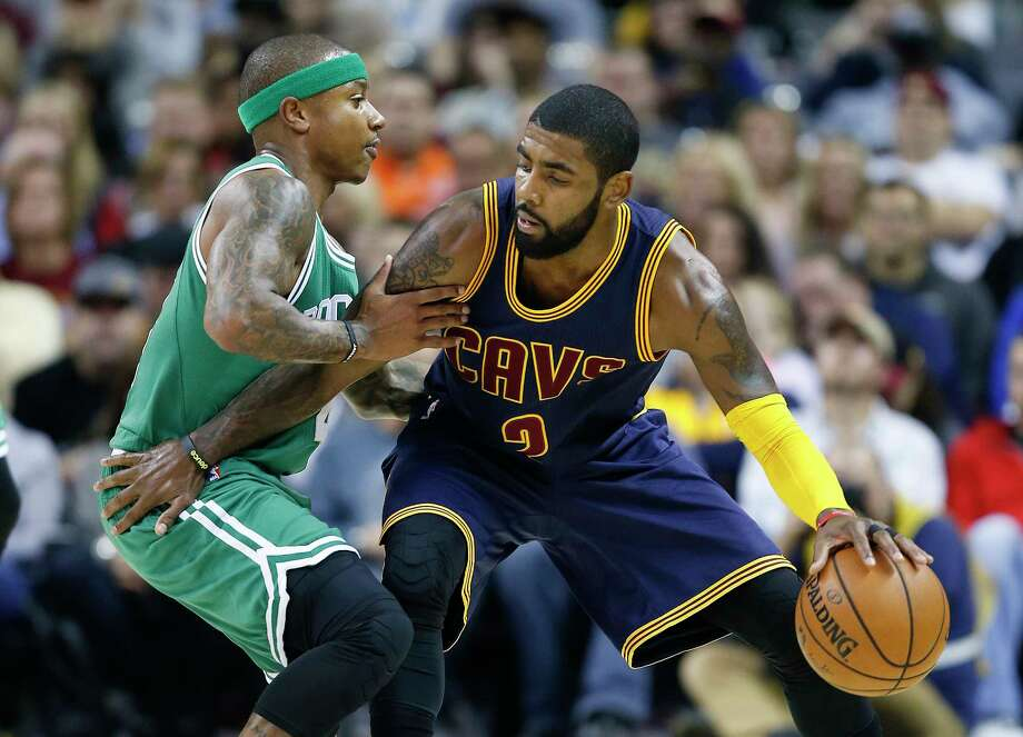 FILE - In this Nov. 3, 2016, file photo, Cleveland Cavaliers' Kyrie Irving, right, looks to drive against Boston Celtics' Isaiah Thomas during the first half of an NBA basketball game in Cleveland. Irving, who asked Cavaliers owner Dan Gilbert to trade him earlier this summer, could be on his way to Boston as the Cavaliers are in serious negotiations with the Celtics about swapping him for point guard Thomas. Since Irving made his stunning request, the defending Eastern Conference champions have been looking for a trade partner. They may have found the perfect one and could be nearing a deal with the Celtics, said the person who spoke Tuesday night, Aug. 22, 2017, to The Associated Press on condition of anonymity because of the sensitivity of the talks. (AP Photo/Ron Schwane, File) Photo: Ron Schwane, FRE / AP 2016