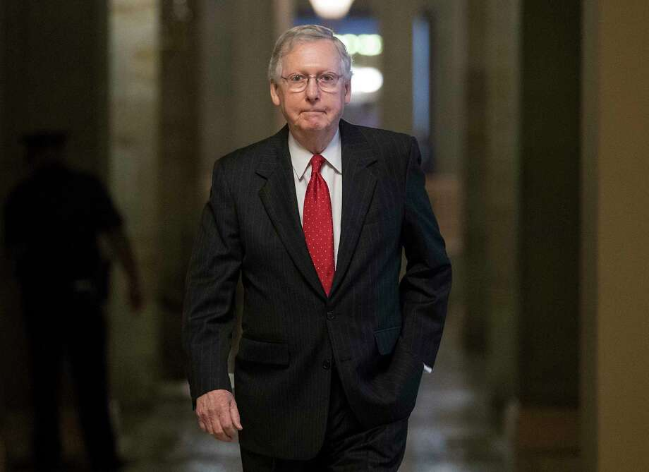 Senate Majority Leader Mitch McConnell of Ky. walks from his office to the Senate floor on Capitol Hill in Washington, Wednesday, July 26. (AP Photo/Carolyn Kaster) Photo: Carolyn Kaster, STF / Copyright 2017 The Associated Press. All rights reserved.