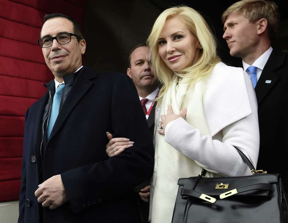 Then-Treasury Secretary-designate Stephen Mnuchin and his then-fiancée, Louise Linton, attend Donald Trump's inaugural. Photo: Saul Loeb, POOL / Pool AFP