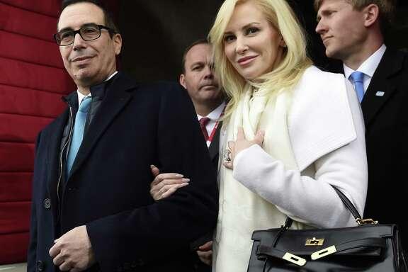 Then-Treasury Secretary-designate Stephen Mnuchin and his then-fiancée, Louise Linton, attend Donald Trump's inaugural.