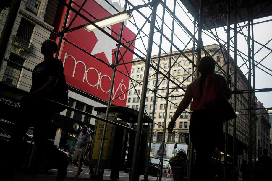Pedestrians walk outside of a Macy's store in New York on Aug. 11, 2016. MUST CREDIT: Bloomberg photo by John Taggart. Photo: John Taggart / Bloomberg