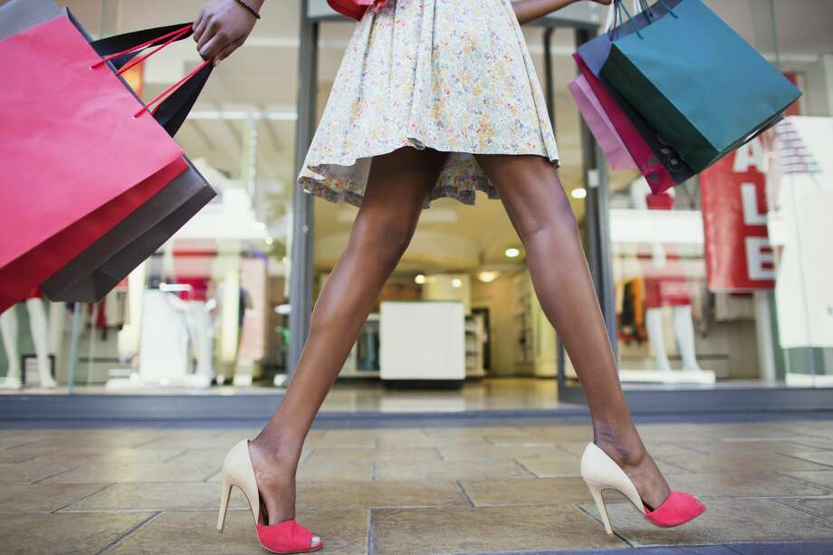 Your Style Unzipped will soon unveil an app that allows Houstonians to browse clothes online, find an item they like and then go to a store to try it before making a purchase. Photo: Dan Dalton/Getty Images/Caiaimage