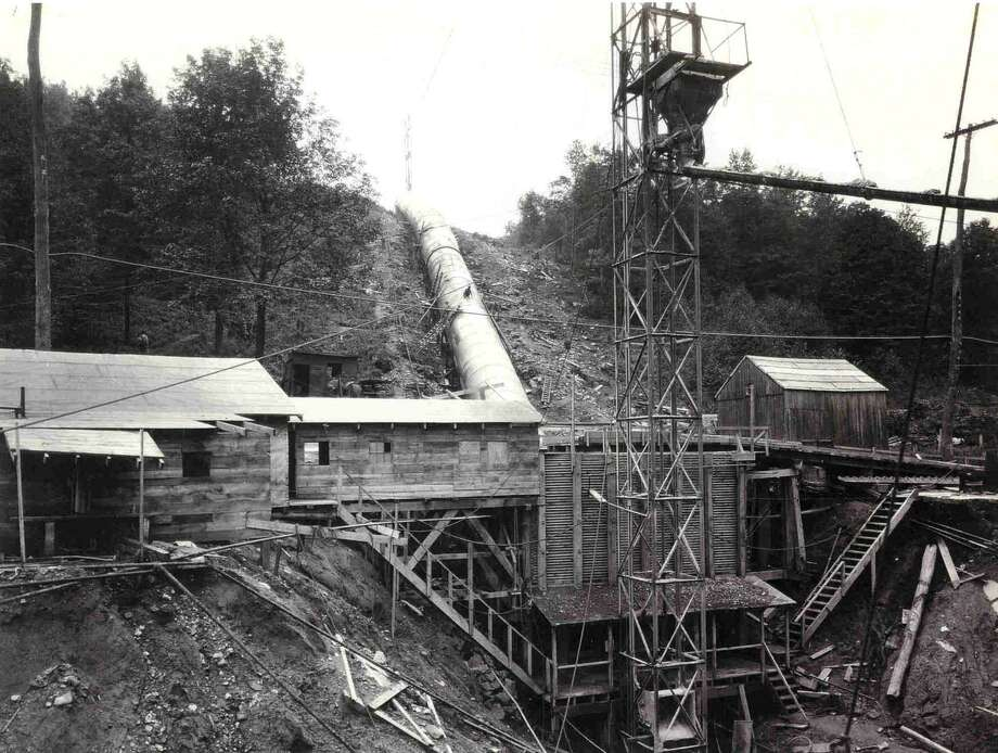 """Construction by Connecticut Light & Power of Candlewood Lake and the Rocky River generating station along Route 7 north in New Milford, Sept. 1, 1927, looking southwest from the powerstation at the erection of a steel penstock to help pump water to the lake from the Housatonic River. If you have a """"Way Back When"""" photograph you'd like to share, contact Deborah Rose at drose@newstimes.com or 860-355-7324. Photo: Contributed Photo / Contributed Photo / The News-Times Contributed"""