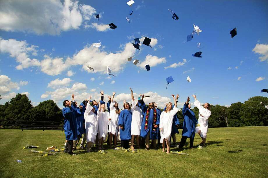 The members of The Glenholme School Class of 2017 celebrate their high school success with the traditional cap toss June 28. Photo: Courtesy Of Glenholme School / The News-Times Contributed